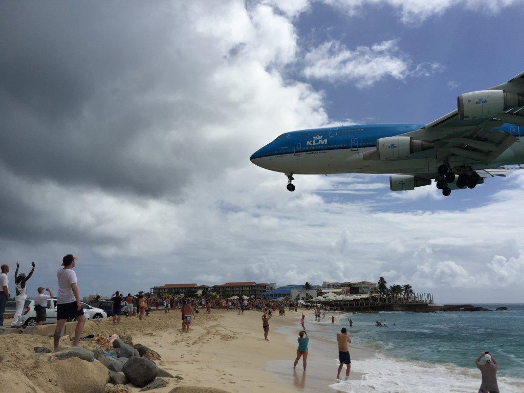 A KLM Boeing 747 landing over Maho Beach
